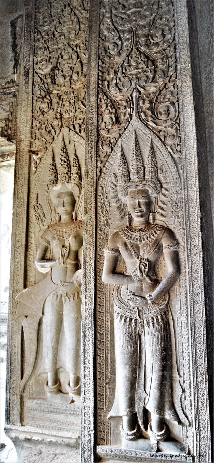 Apsaras carved on a pillar in the uppermost terrace (Bakan) of the Angkor Wat Temple, Siem Reap, Cambodia