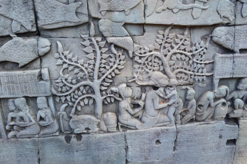 A section of the bas-relief on the lower level gallery of the Bayon temple depicting a daily life scene
