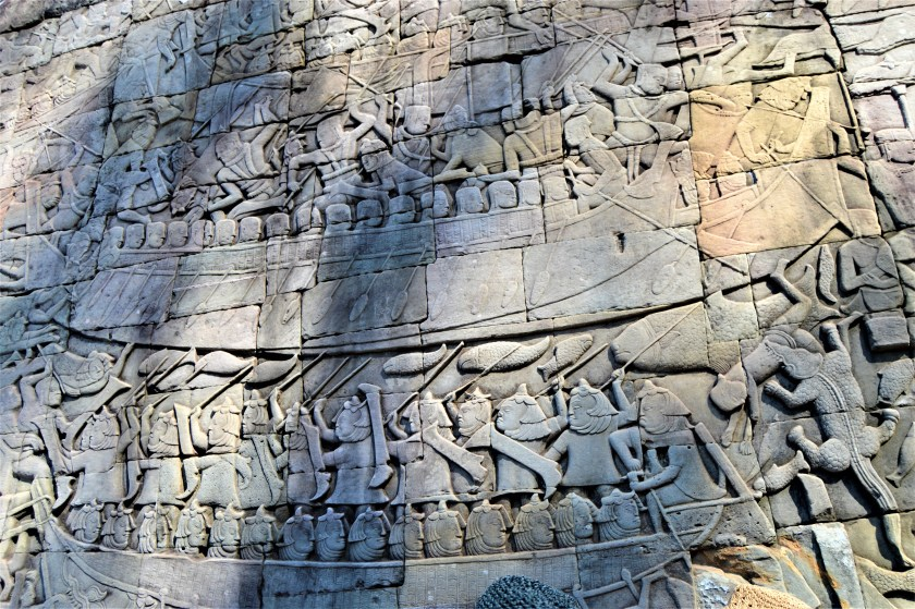 A section of the bas-relief on the lower level gallery of the Bayon temple depicting Khmer vs. Champs naval war