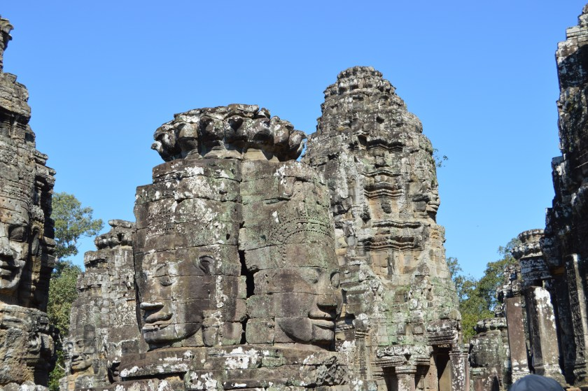 Towers on the upper level of the Bayon Temple carved with smiling faces