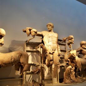 Statue of Apollo in the middle of the west pediment of Temple of Zeus at Olympia, Greece