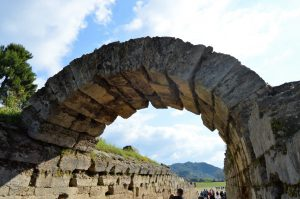 Arch at the entrance to the stadium where the ancient Olympic Games were held located in Olympia, Greece