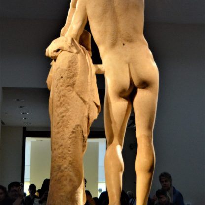 Rear view of the statue of Hermes of Praxiteles on display at the Olympia Archaeological Museum in Olympia, Greece