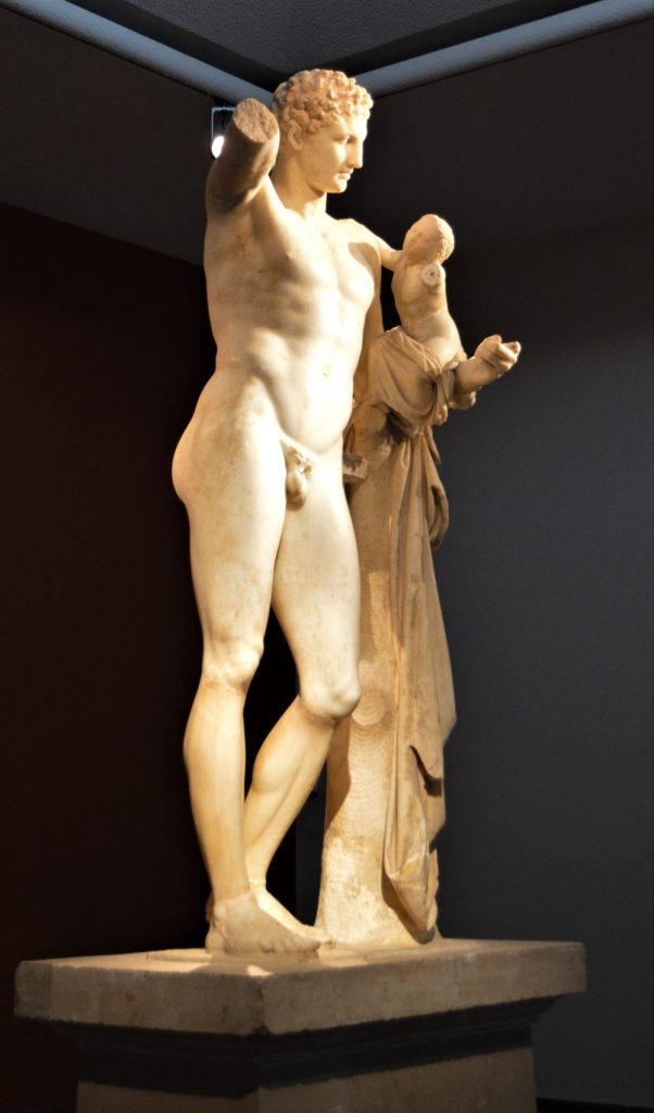 Front view of the statue of Hermes of Praxiteles on display at Olympia Archaeological Museum in Olympia, Greece