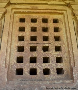 Jālandhara with square perforations installed in a wall surrounding sabhamantapa and garbhagriha of the Durga Temple at Aihole, Karnataka, India