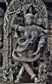 Belur Chennakeshava Temple - Sculpture of a shilabalike chasing a monkey pulling her dress mounted on a pillar