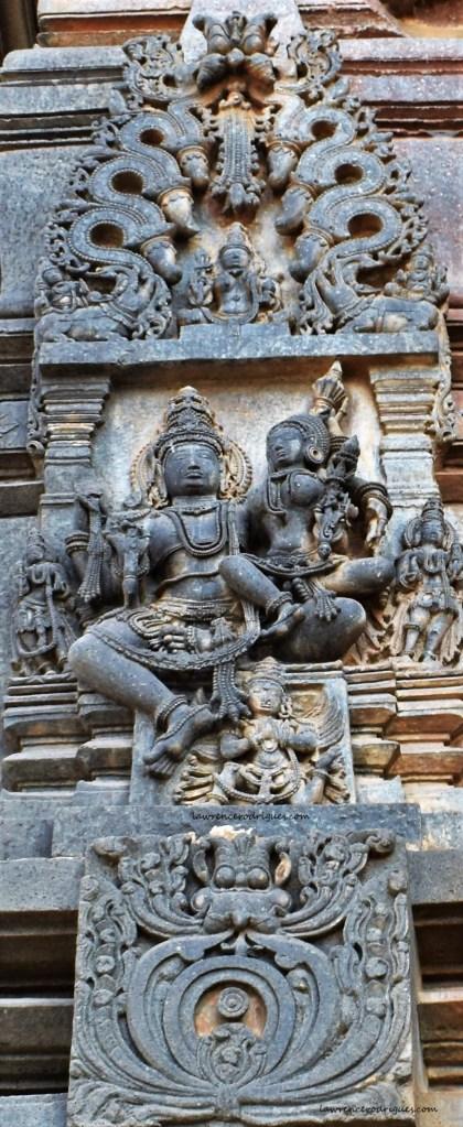 Sculptural relief depicting Vishnu with Lakshmi carved on the south-side exterior wall surrounding the garbagriha (sanctum sanctorum) of the Belur Chennakeshava Temple in Karnataka, India