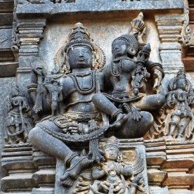 Sculptural relief depicting Vishnu with Lakshmi carved on the south-side exterior wall surrounding the garbagriha (sanctum sanctorum) of the Belur Chennakeshava Temple in Karnataka, India