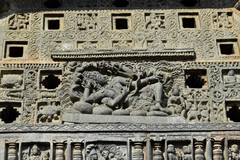 Vishnu reclining on Adishesha - A beautifully carved relief on a jālandhara in the Belur Chennakeshava Temple in Karnataka, India