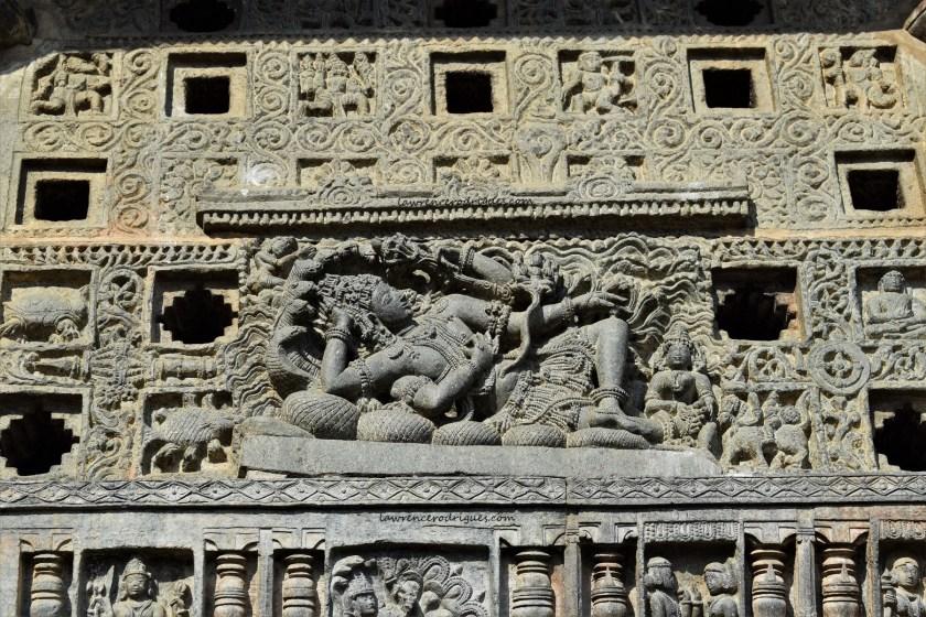 Vishnu reclining on Sheshanaga - A beautifully carved relief on a Jalandhra in the Belur Chennakeshava Temple in Karnataka, India
