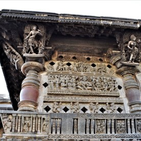 Hoysala King Vishnuvardhana carved on the right side jālandhara of the front facade of the Belur Chennakeshava Temple, Karnataka, India