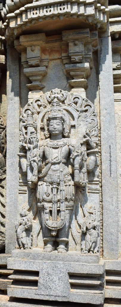 Surya, the sun god, carved into the outer wall of the Somanathapura Keshava Temple in Karnataka, India