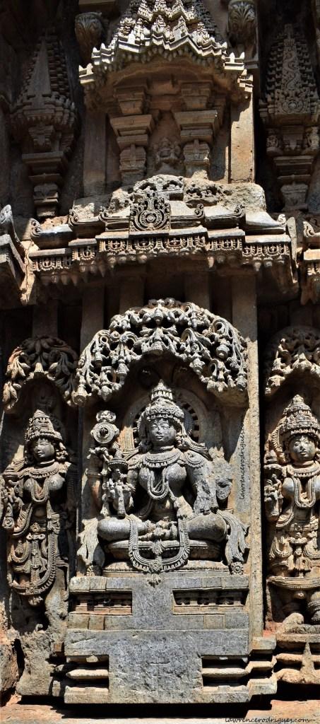 Mohini - A sculpture depicting female avatar of Vishnu carved on the outer wall of Somanathapura Keshava Temple in Karnataka, India
