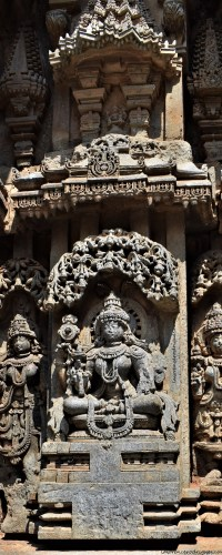 Mohiniavatara - A sculptural relief depicting female avatar of Vishnu carved on the outer wall of Somanathapura Keshava Temple in Karnataka, India