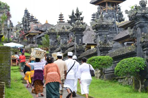 Devotees carryoing offering entering Besakih Temple in Bali, Indonesia