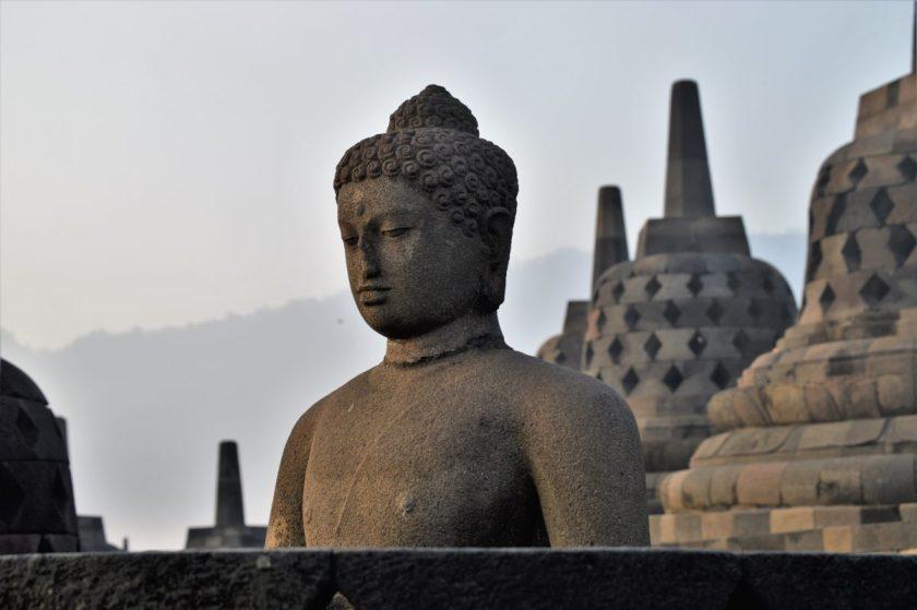 A Buddha statue on the top terrace of Borobudur in Yogyakarta, Indonesia.
