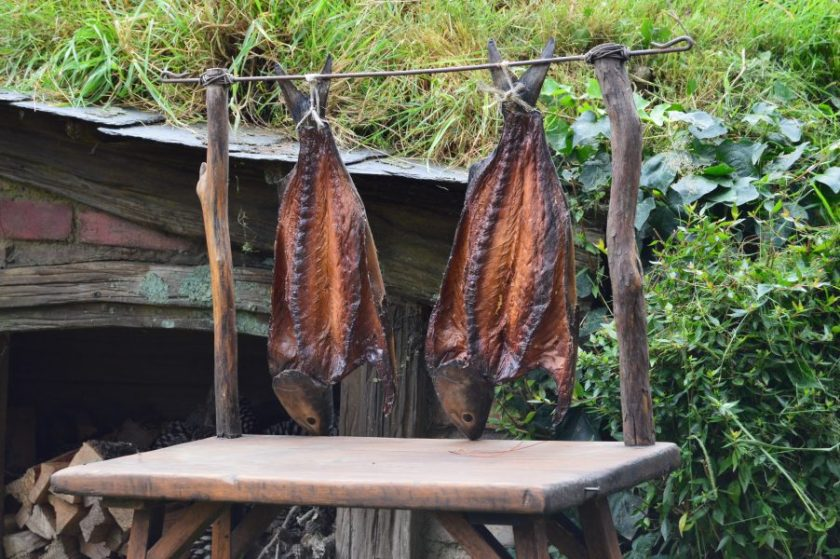 Smoked fish hanging in front of a hobbit hole in the Hobbiton Movie Set, New Zealand