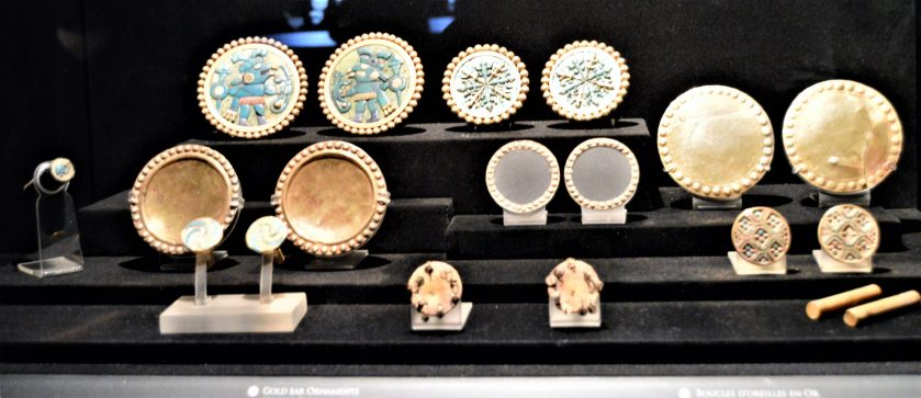 Moche gold ear pieces on display at Museo Larco in Lima, Peru