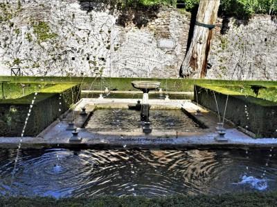 Pond with a fountain in the Patio de la Sultana (Sultana's Court) in the Generalife, Granada, Spain