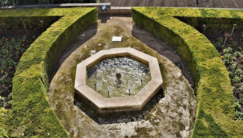 An octagonal basin in the lower gardens of the Generalife in Granada,Spain