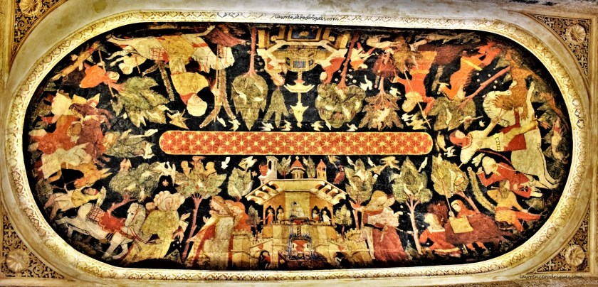 A painting depicting everyday life on the ceiling of the Hall of the Kings located inside Nasrid Palaces in Alhambra, Granada, Spain