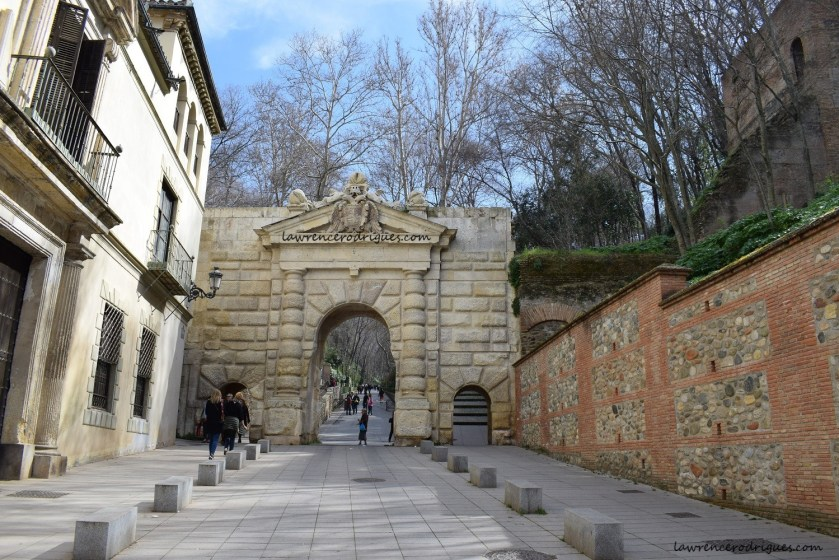 Front facade of the Puerta de las Granadas (Gate of the Pomegranates) in the Alhambra, Granada, Spain