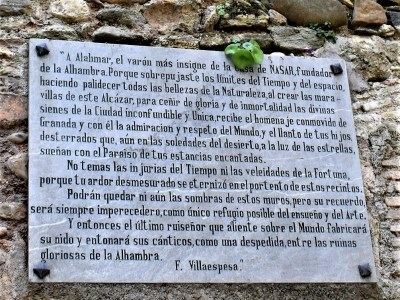 Tombstone that pays tributes to Alahmar, the founder of the Alhambra mouted on a wall near the Gate of the Pomegranates in Granada, Spain