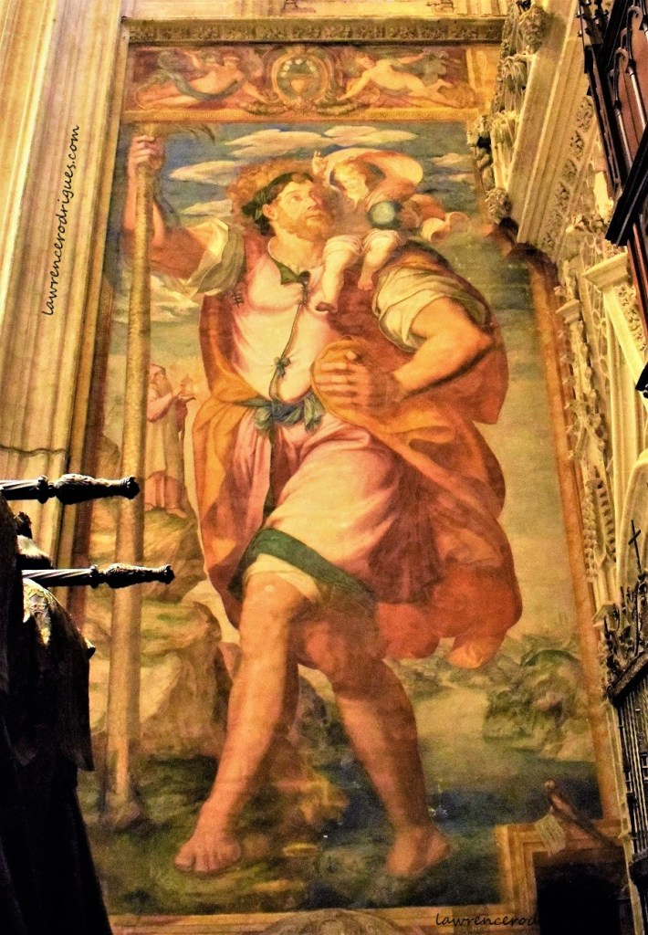 San Cristóbal fresco by Mateo Pérez de Alesio sitauted on a wall next to the tomb of Columbus in the Seville Cathedral