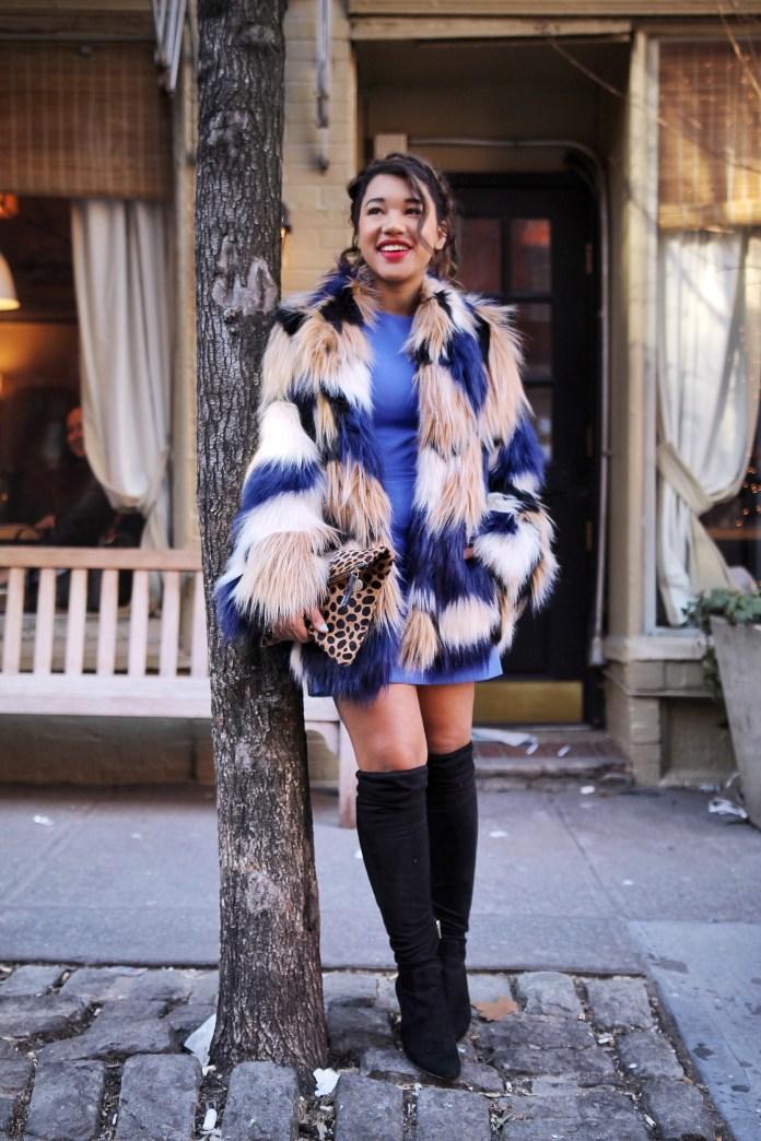 Яркая шубка из искусственного меха, такое же яркое платье, стильные и ультрамодные в 2016 году сапоги-ботфорты.