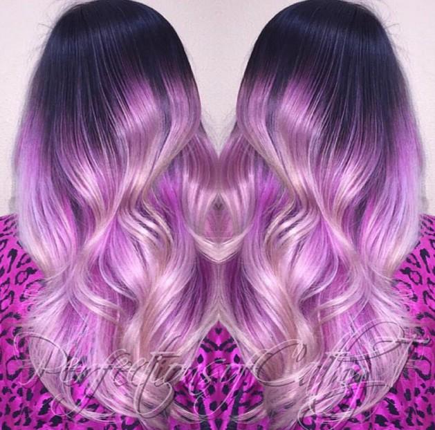 Новый тренд в окрашивании - оттенок омбре - переход от тёмных корней к белым кончикам через целую гамму фиолетовых оттенков.