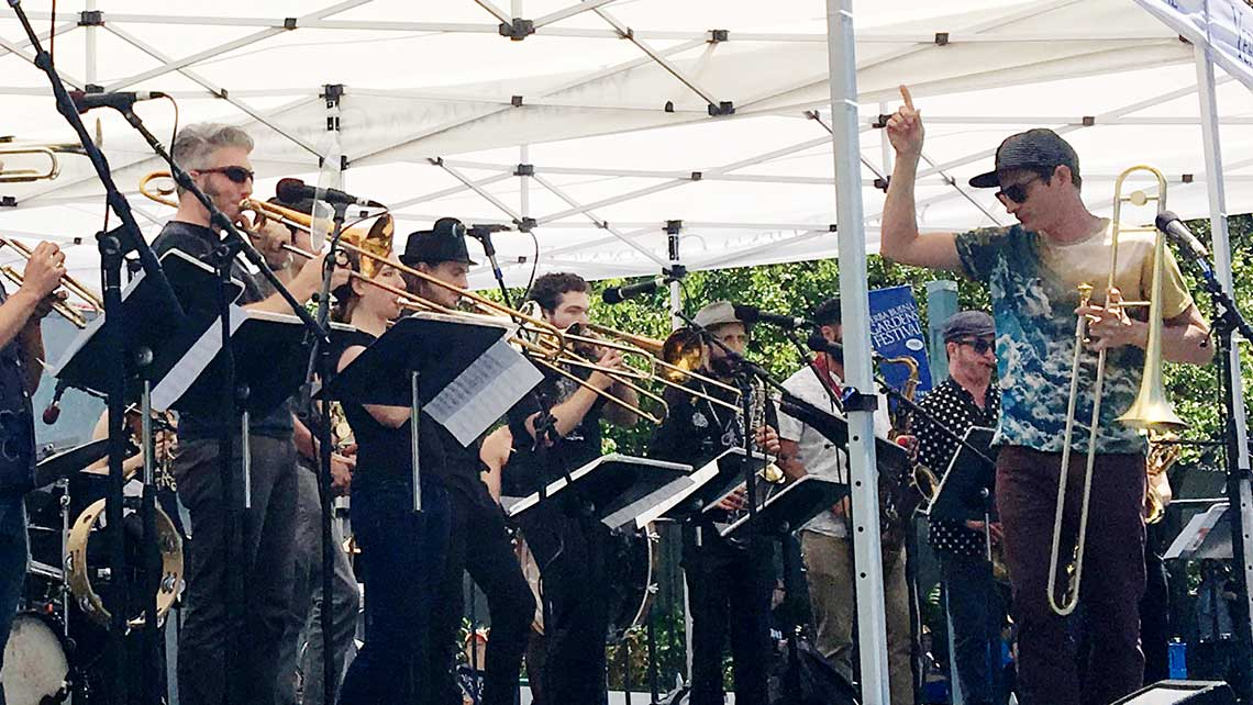 Photo of Adam Theis conducting The Brass Convergence
