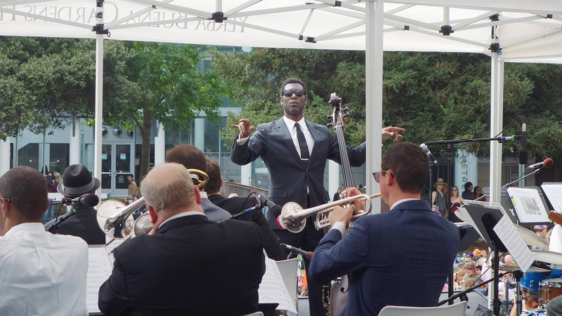 Photo of Marcus Shelby conducting his orchestra