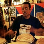 photo of John Santos drumming