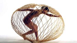 Slow Research Lab: Photo of a dancer inside of a bamboo sphere