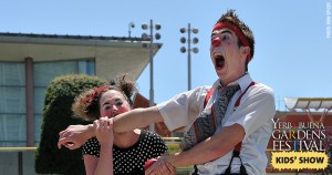 Photo of Pi Clowns by John Spicer: one clown biting another's arm