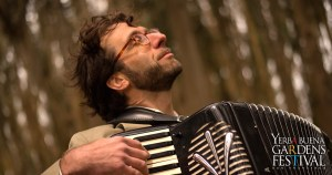Photo of musician Rob Reich playing the accordion