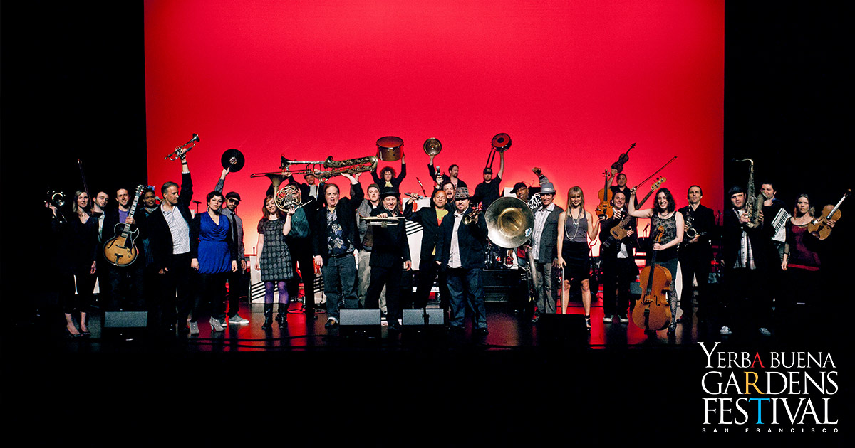 Photo of large group of musicians on stage for Brass, Bows and Beats