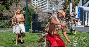 Photo of 3 male Pomo dancers performing outdoors. Photo by Jim Watkins Photography.