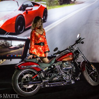 Las Vegas, NV - April 18, 2016: A model poses with a motorcycle to demonstrate the performance of state-of-the-art video cameras at the NAB Show. Photo by James Mattil, YBLTV Writer / Reviewer / Photographer.