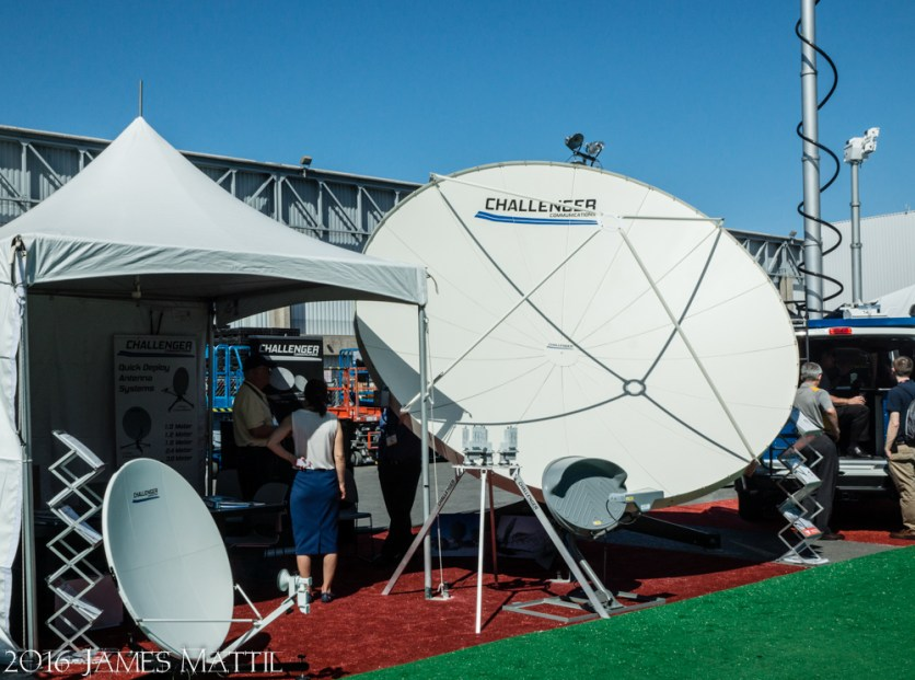 Las Vegas, NV - April 18, 2016: An exhibitor displays a range of various satellite dishes at NAB. Photo by James Mattil, YBLTV Writer / Reviewer / Photographer.