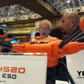 Yuneec USA, Inc.'s, Territory Manager, Kevin Jones shows an attendee the company's H520 at InterDrone 2017.