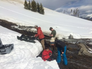 YC, Confluence Engineering and Gallatin River Task Force testing water below the pond