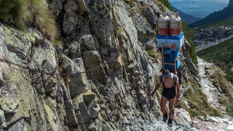 Sherpas carry food, beverages, firewood and fuel in massive loads that often weigh more than 100kg (Credit: Credit: Štefan Bačkor)