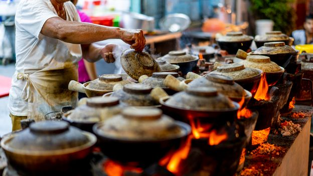 The city-state's once-ubiquitous street food vendors have been moved into hygiene-regulated, covered hawker centres (Credit: Credit: Jimmy Fam/Getty Images)