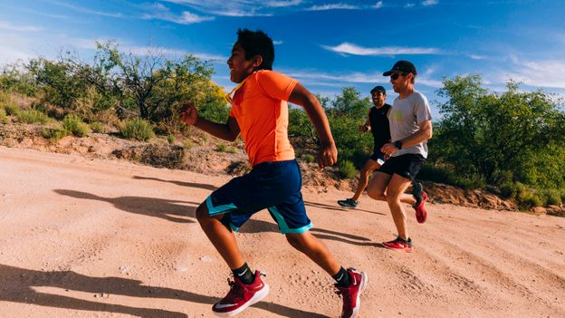 """As part of  the """"Invisible Walls"""" expedition, the athletes ran beside O'odham youth through southern Arizona (Credit: Credit: Aaron Colussi)"""