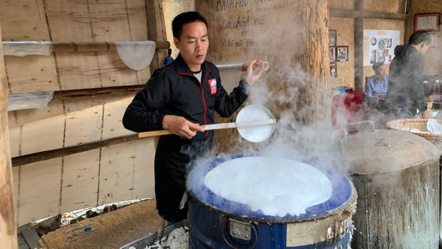 Vu Ngoc Vuong, who comes from a long line of pho masters, owns a rice noodle workshop in Hanoi (Credit: Courtesy of Vu Ngoc Vuong)