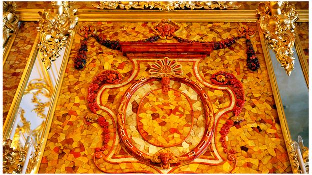 Like the original, the recreated Amber Room features amber mounted on gold-leaf walls (Credit: Credit: Ivan Vdovin/Alamy)