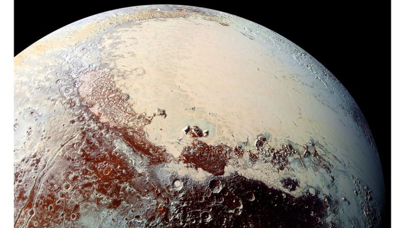 Pluto's Sputnik Planitia glacier is primarily made from nitrogen ice, and contains thousands of pits suspected to be caused by floating islands of water ice (Credit: Alamy)
