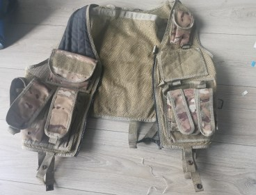 Battle vest and pistol