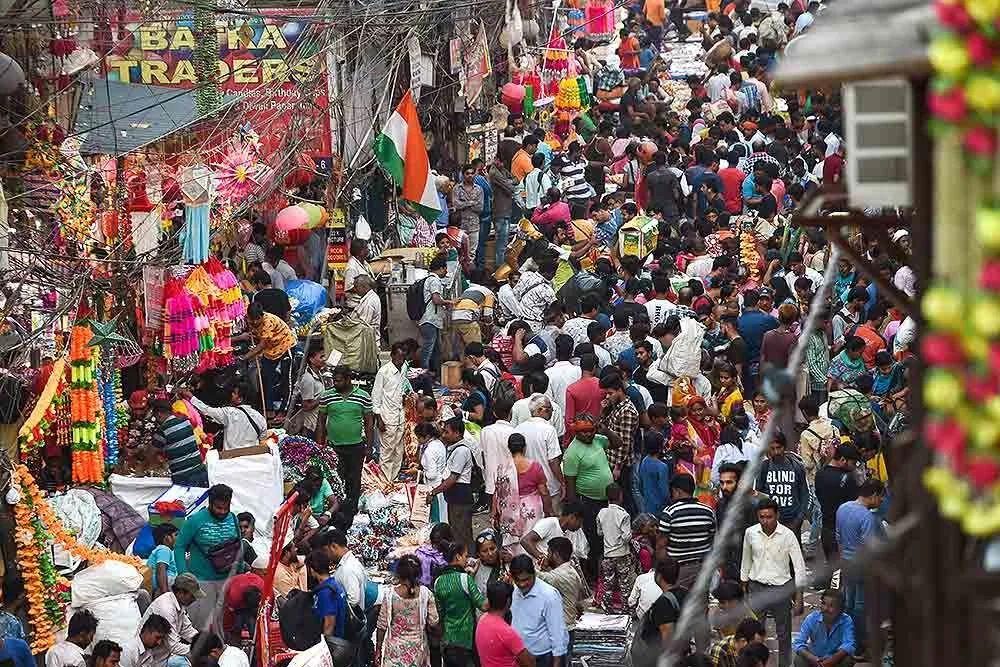 "Tourists enjoy the emergence of ""poison bubbles"" on the coast of India."